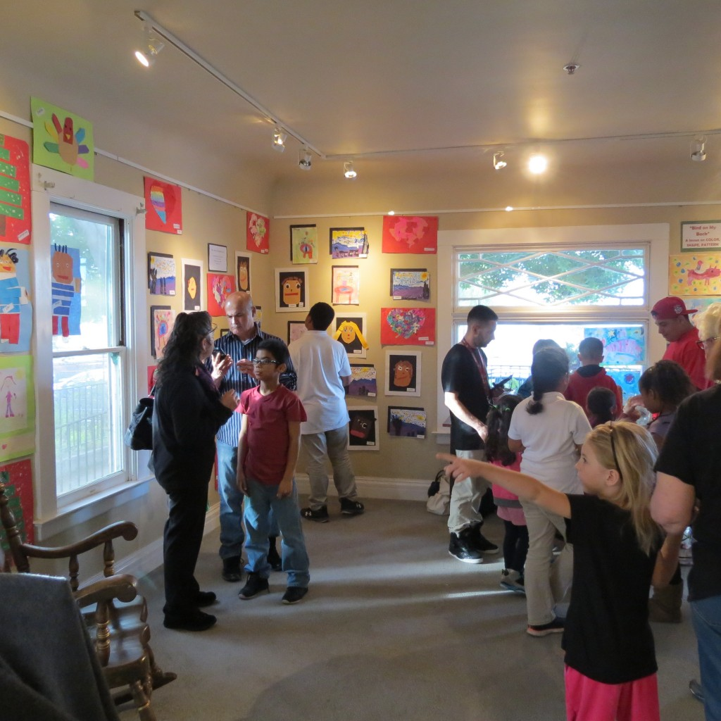 Students and residents attend the Sutter Elementary School Art Exhibit at the Lynn House Gallery in March.