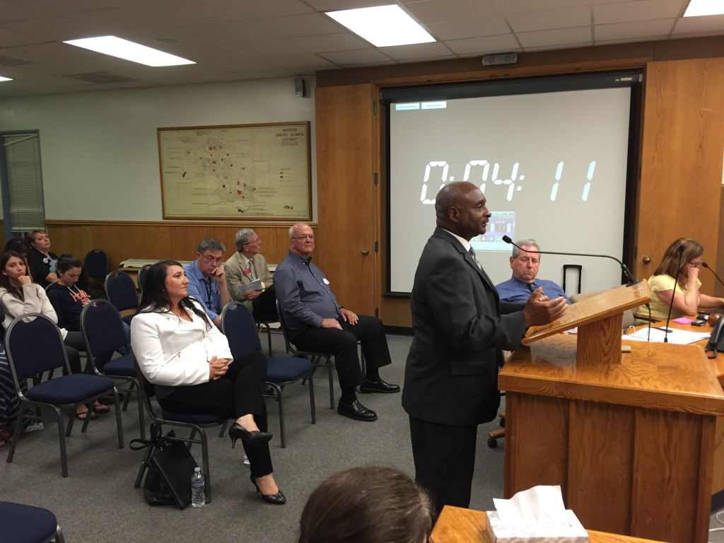 Alonzo Terry answers questions in round three during Wednesday night's Antioch School Board meeting, while the two other remaining candidates, Candy Amigo and Gary Hack listen.