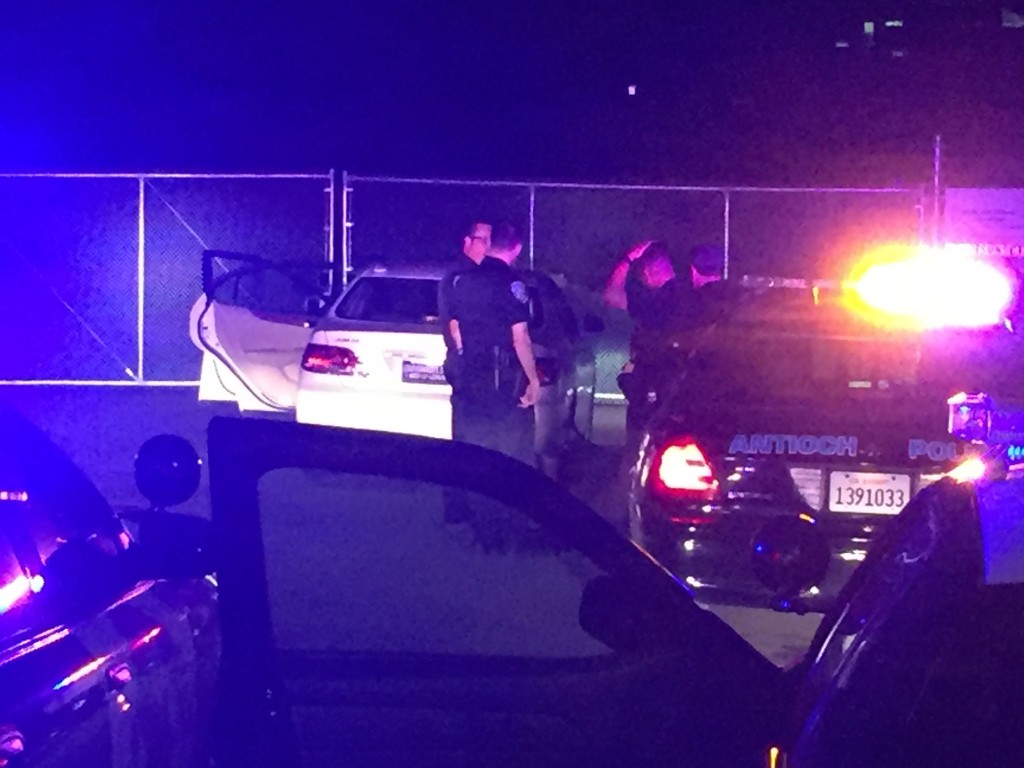 Antioch Police investigate the suspect's car at the end of the BART Park n Ride lot access road, following the end of the chase, late Monday night/early Tuesday morning.