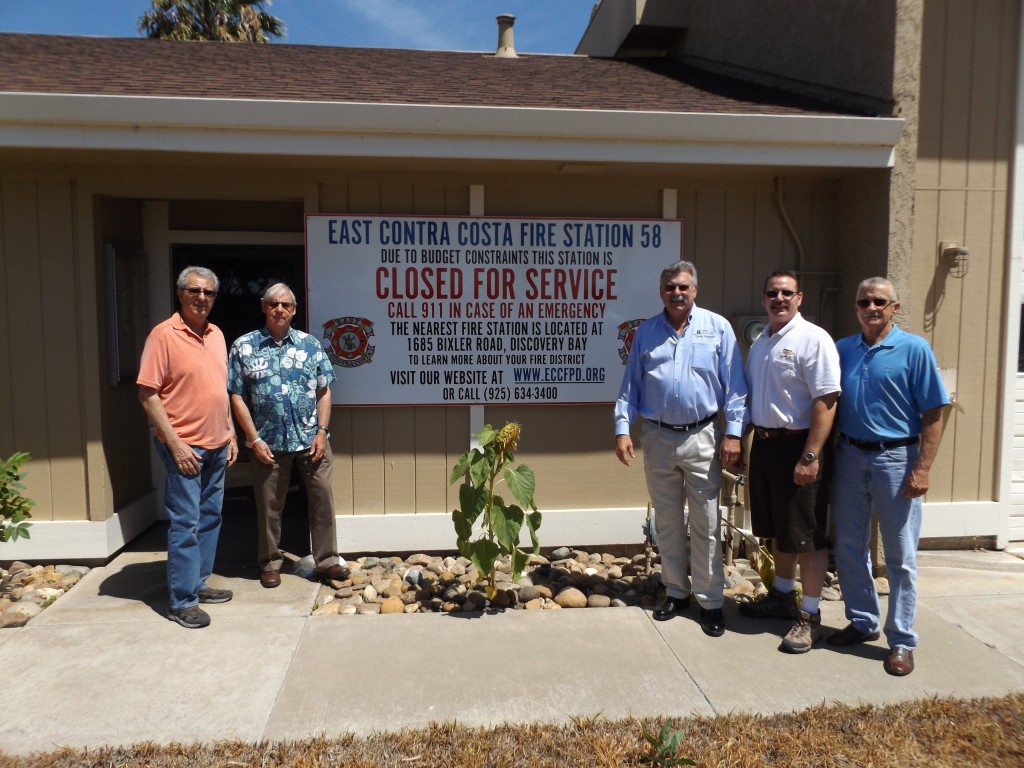 Members of the East County Voters for Equal Protection Phil Mora, Hal Bray, Rob Broocker and Bob Bay, with Doug Hardcastle (center) at the closed fire station in Discovery Bay.