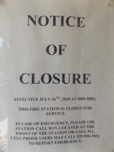 Sign in the window of the closed Discovery Bay fire station.