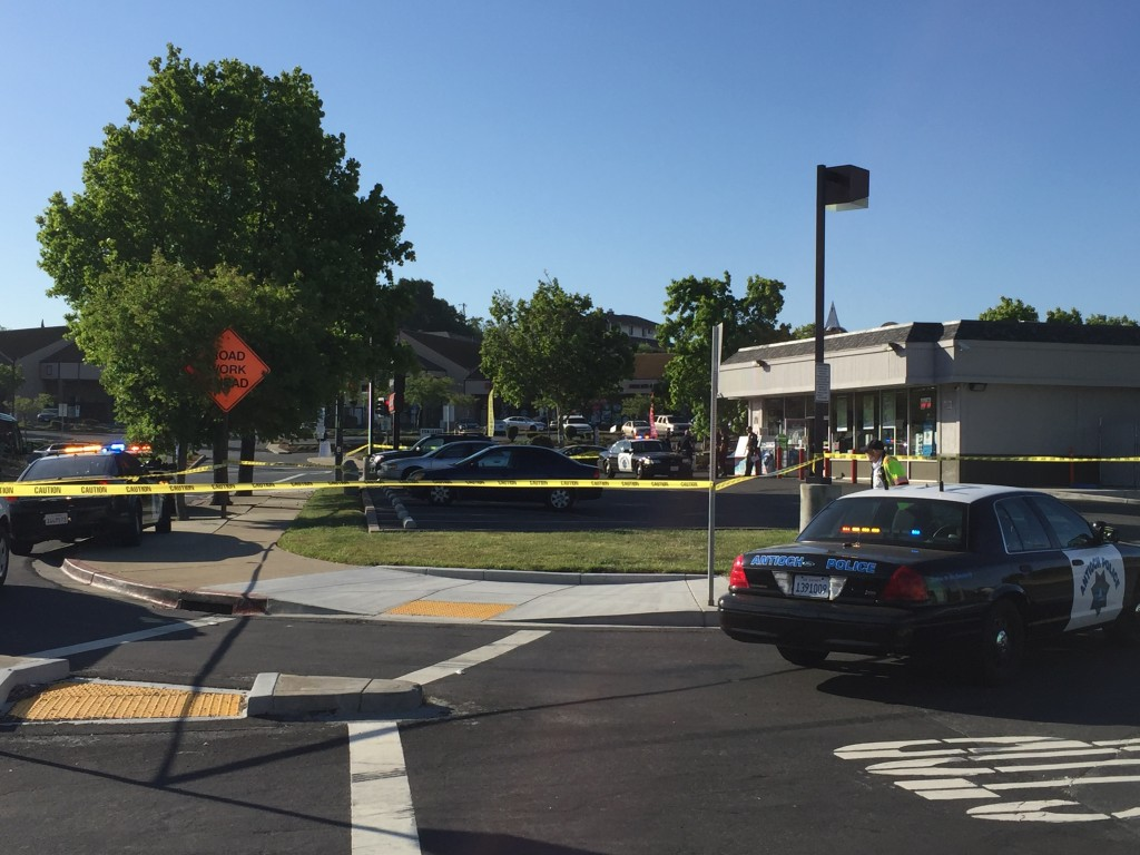 Antioch Police had the QuickStop convenience store and parking lot on W. Tregallas cordoned off, during the investigation of the shooting homicide, Monday morning, May 2, 2016.
