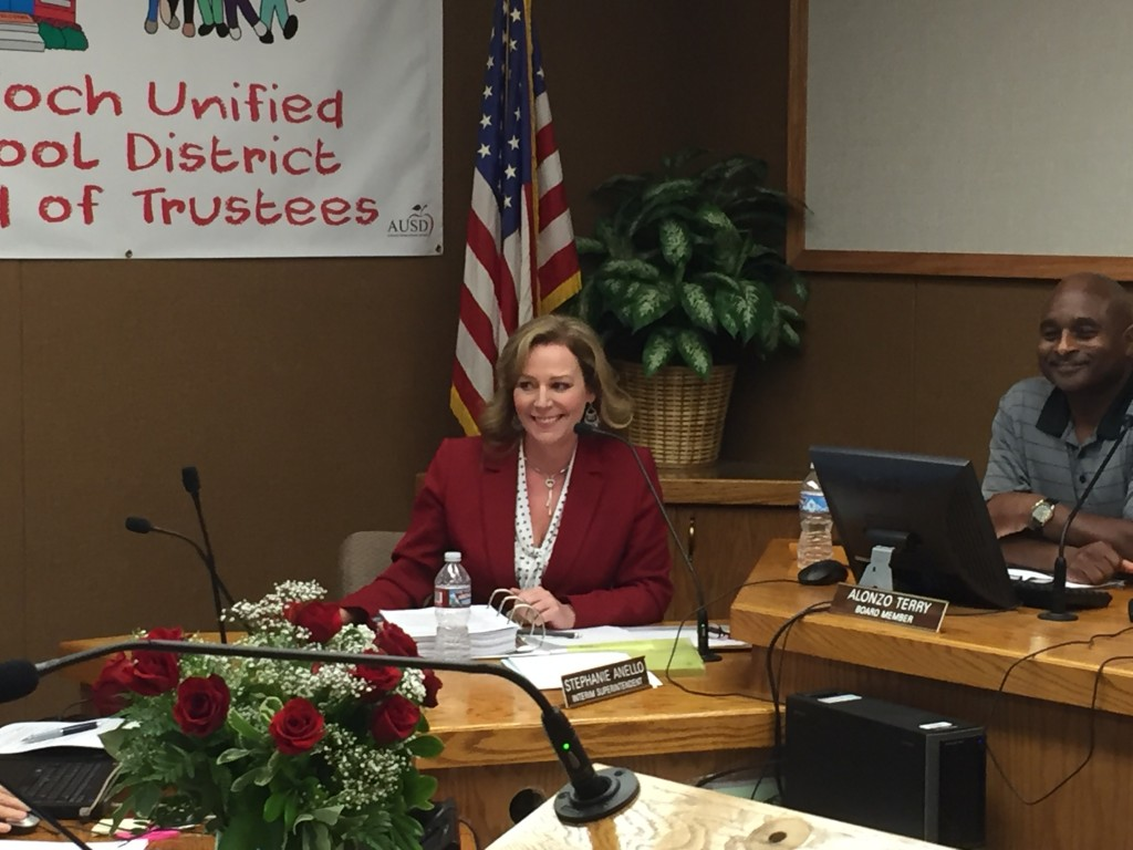 New Antioch schools Superintendent Stephanie Anello smiles to the applause of the audience following the vote to hire her by the Board, at their meeting, Wednesday night, June 22, 2016.