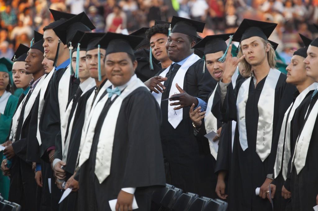 Excited Deer Valley grads prepare to receive their diplomas. By Luke Johnson