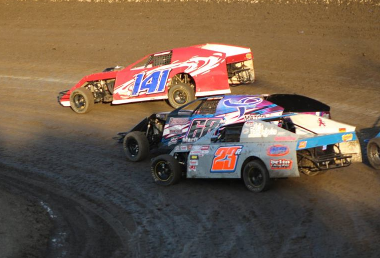 Trent Wentworth #141 leads John MacDougall #68 and Raymond Linedman #23 in a battle of Top 5 A Modified point contenders.  Photo by Ryan Brown.