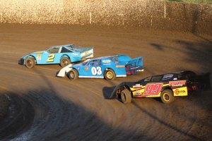 Limited Late Model All Time feature win leader Mike Gustafson #2 leads rookie Kimo Oreta #03 and Jim Freethy #99 in a heat race.  Photo by Ryan Brown.