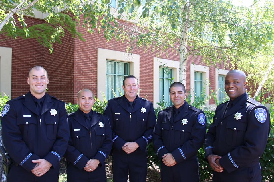 From left: Officers Matthew Davis, Wilson Delacruz, Salvador Montanez and Quamaine Murphy with Chief Allan Cantando, center.