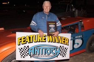 At 87 years of age, Limited Late Model feature winner Larry Damitz #15 is still not slowing down.  Photo By Paul Gould Photography