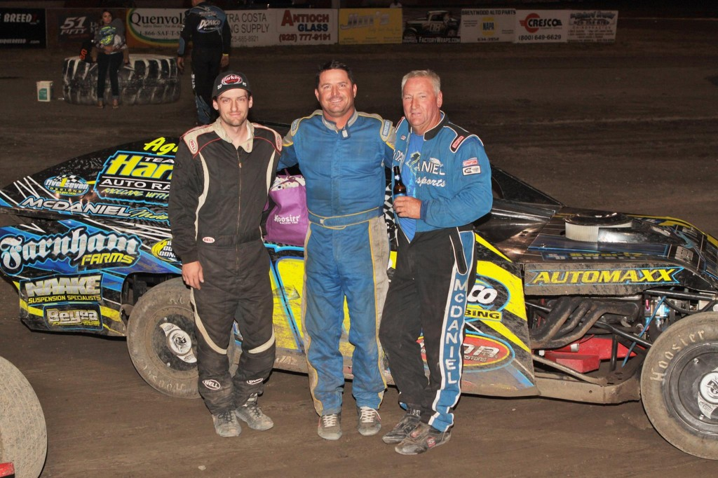 The A Modified Main Event Podium for the Jerry Hetrick Memorial Race.  Left to right is Cody Burke (second place), Darrell Hughes II (third place) and Randy McDaniel (first place).  Photo By Paul Gould Photography