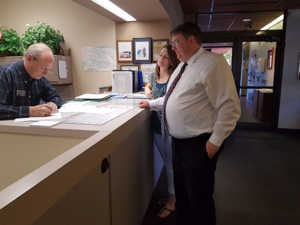 Sean Wright, with his wife Lani, submits his filing papers to run for Mayor of Antioch, to Antioch City Clerk Arne Simonsen on Tuesday, July 19.