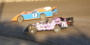 Limited Late Model point leader Larry Damitz #15 and Mark Garner #76 battle for a heat race win.  Photo By Ryan Brown.