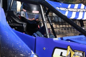 NFL Alumnus Jeremy Newberry #62 has his game face on before a Wingless Spec Sprint heat race.  Newberry won a Main Event a few weeks ago.  Photo by Ryan Brown.