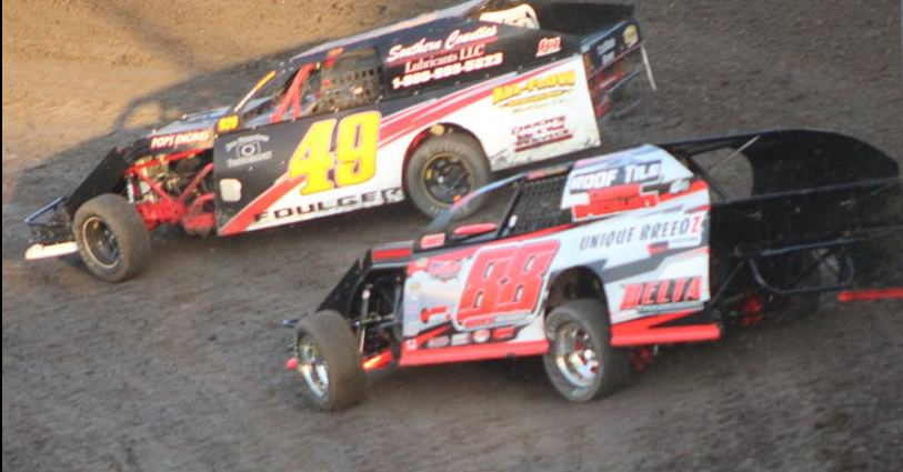 Four time A Modified champion Troy Foulger #49 and point leader leader Carl Berendsen II #88 battle for position.  Photo By Ryan Brown.