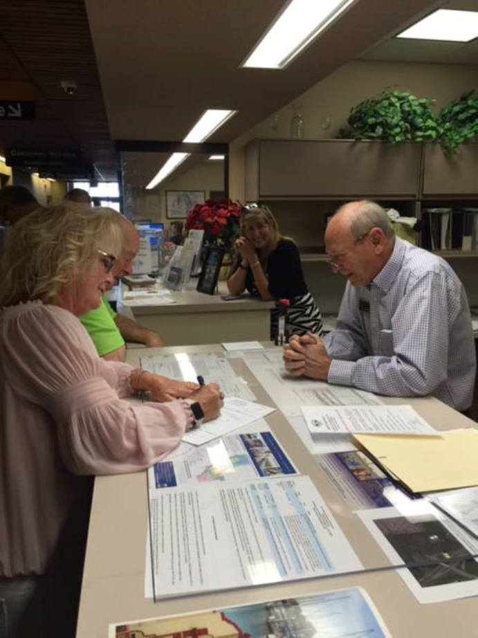 Antioch Mayor Pro Tem Lori Ogorchock files her papers with City Clerk Arne Simonsen as Campaign Treasurer Bill Chapman and friend Kristen Vistalli look on.