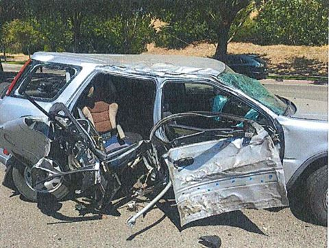 The victims' car following the chase and collision with her ex-boyfriend and father of their son, Thursday morning.