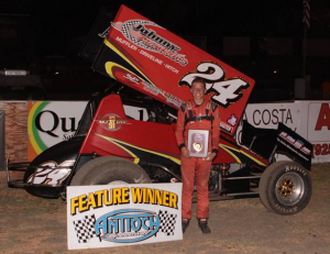 Fourth generation racer Colby Johnson #24 became the 11th different Winged 360 Sprint Car Main Event winner of the season.  Photo By Paul Gould