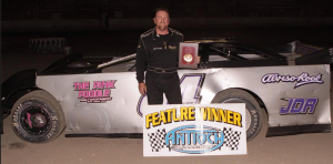 Jeff Decker #84 won his second DIRTcar Late Model Main Event, but he came up just short in the championship battle.  Photo By Paul Gould