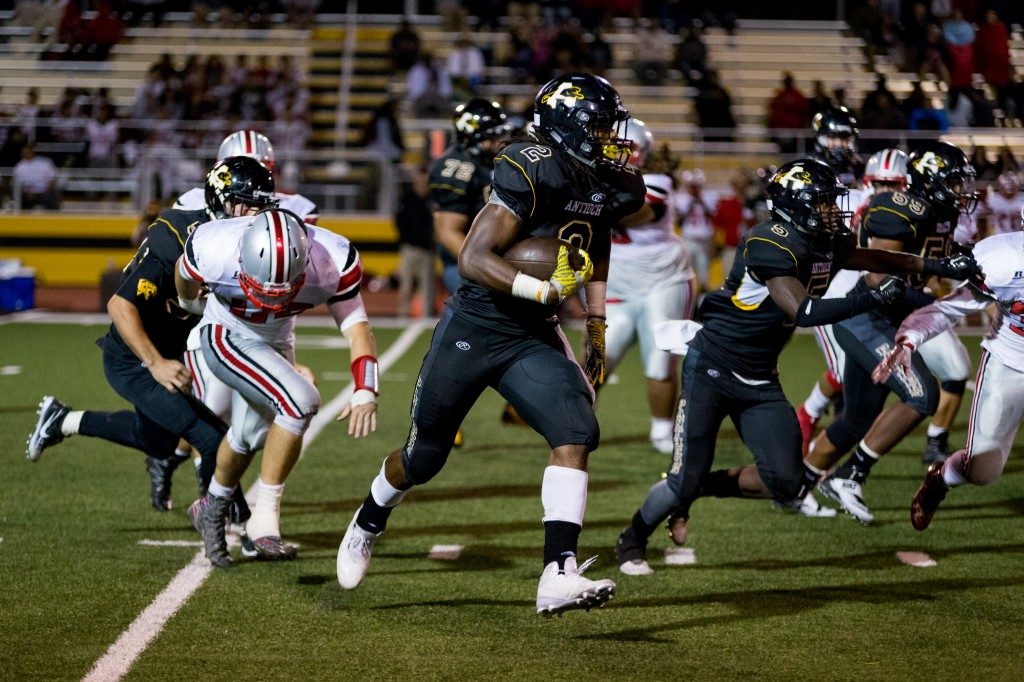 America's top high school running back and college recruit, Najee Harris carries the ball past defenders of Lincoln High of Stockton, Friday night, August 26, 2016. photo by Michael Pohl