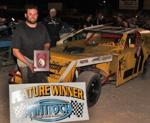 Nick DeCarlo borrowed the Lloyd Cline #11 car and drove it to victory in the B Modified Main Event.  In the background is second place finisher Trevor Clymens #2c.  Photo By Paul Gould