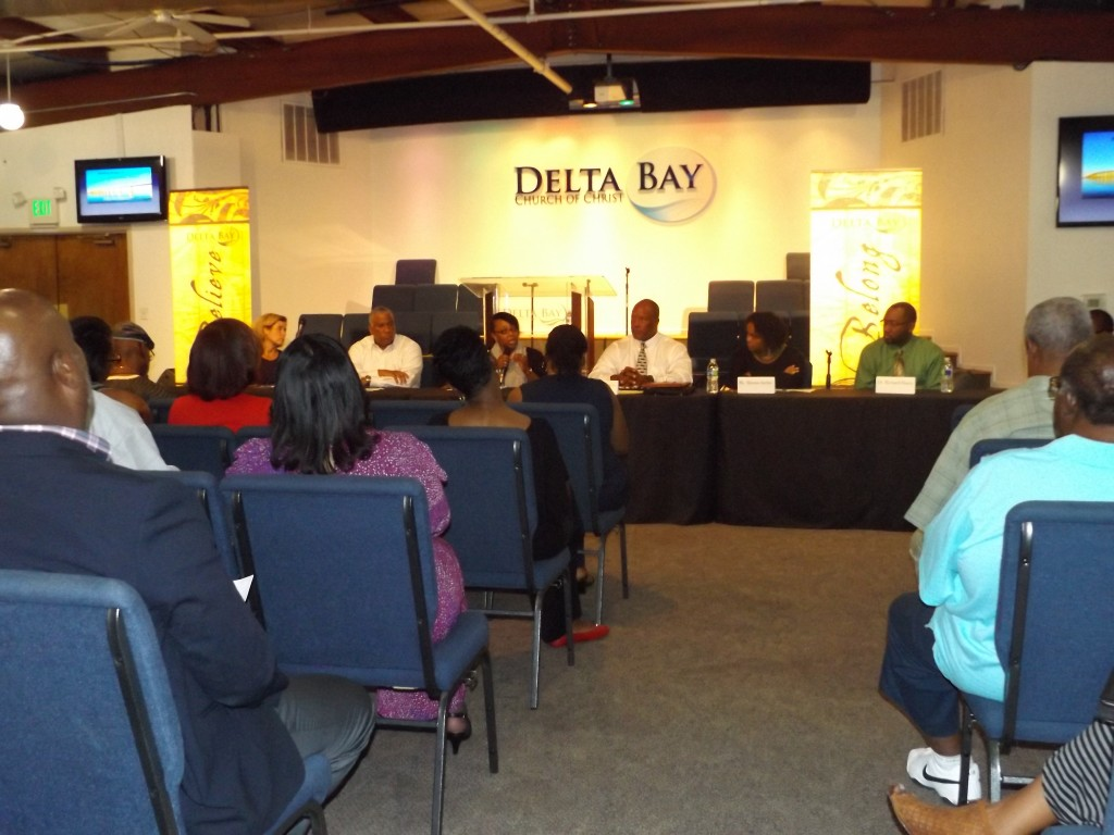 Tamisha Walker, a re-entry professional and former convict, (center) speaks during the symposium, as the other panelists (from left to right), Mary Kelly Persyn, founder and principal of Persyn Law & Policy, Sgt. Joe Johnson of the California Highway Patrol, Retired Oakley Police Officer Mark Hicks, who has a background in stolen car defense training, nurse Shonta Archie, and mental health professional and clinical therapist Dr. Richard Hanzy, look on. photo by Allen Payton