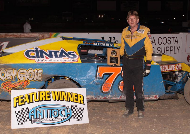 Scott Busby's #73 division record 65th career A Modified feature win was worth $1,500.  Busby now has 71 career wins, which leaves him one win behind speedway legend J.D. Willis for the lead on the all time list.  Photo by Paul Gould