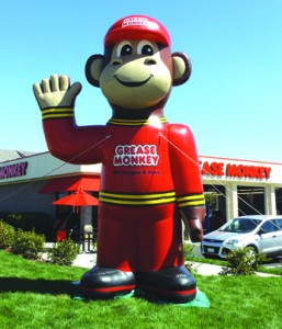 The big Grease Monkey balloon will greet you at the corner of Auto Center Drive and West 18th Street.