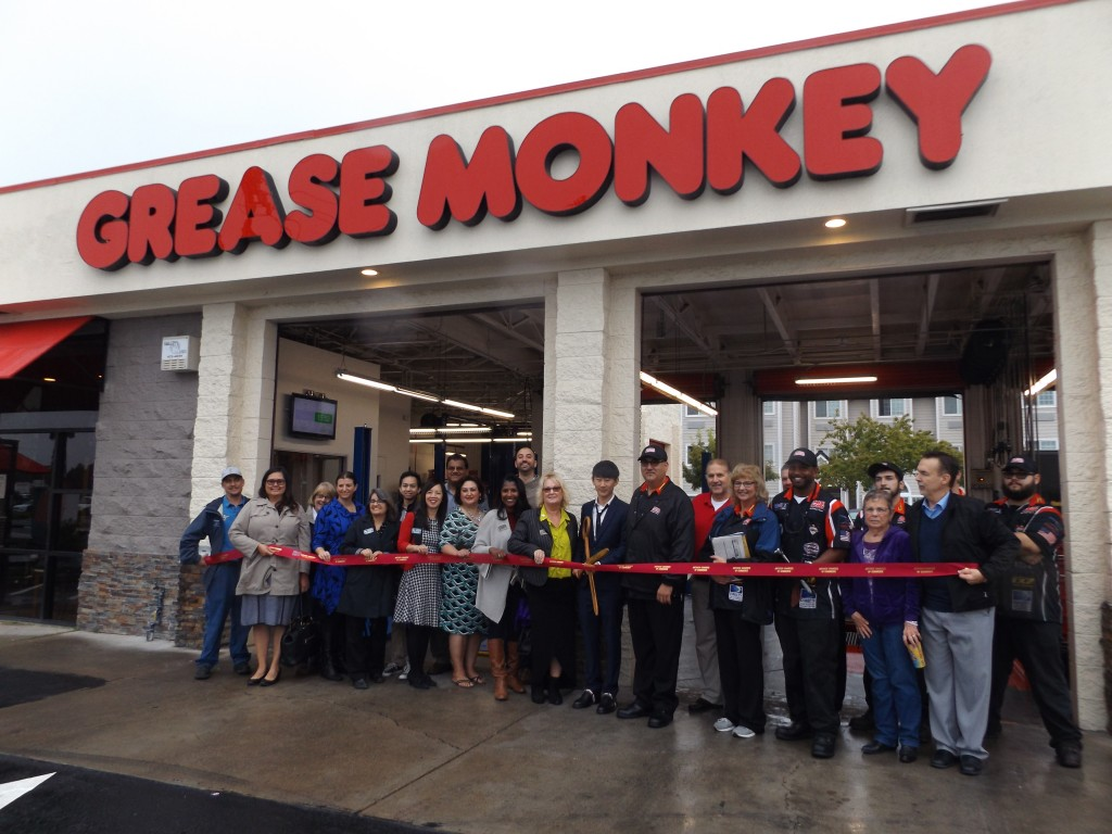 Owner Brian Li, with scissors, prepares to cut the ribbon to officially open the new Grease Monkey in Antioch on Friday, October 28, 2016.