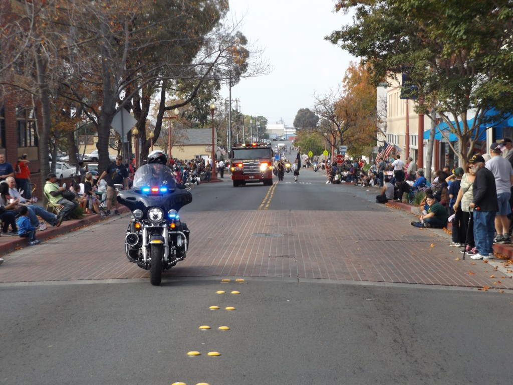 Antioch Police Motorcycle Officer Robert Solari leads off the Annual Veterans Day Parade on West 2nd Street in historic, downtown Rivertown, Friday, November 11, 2016.
