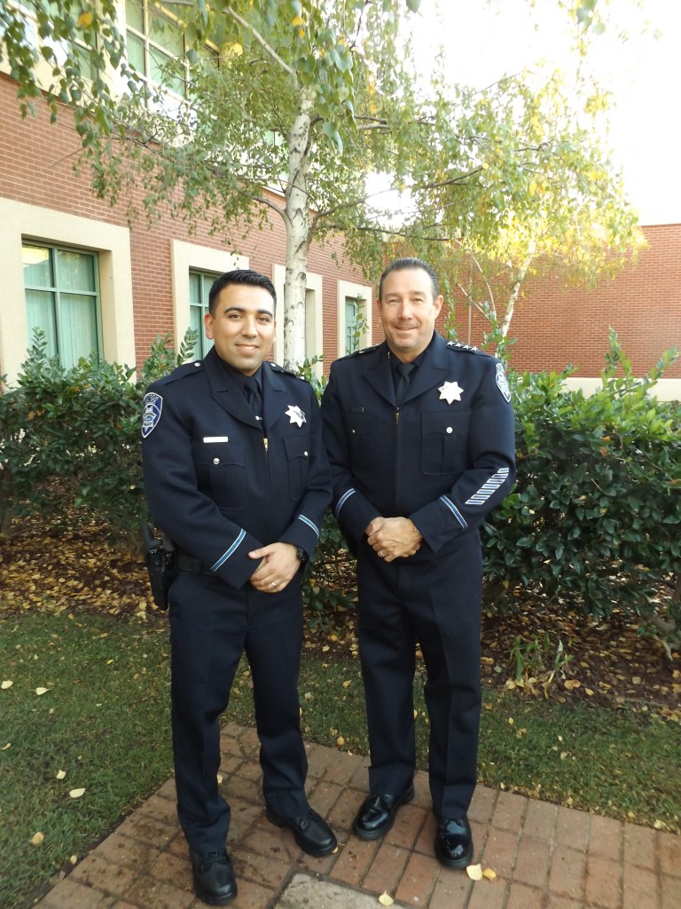 Antioch's newest Police Officer Steven Millan-Estrada and Chief Allan Cantando, following Millan's oath of office ceremony, Monday afternoon, November 14, 2016.