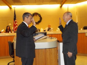 County Clerk Joe Canciamilla administers the oath of office to City Clerk Arne Simonsen.
