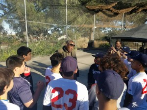 Dusty Baker speaks with the Game Changers Little League baseball team.