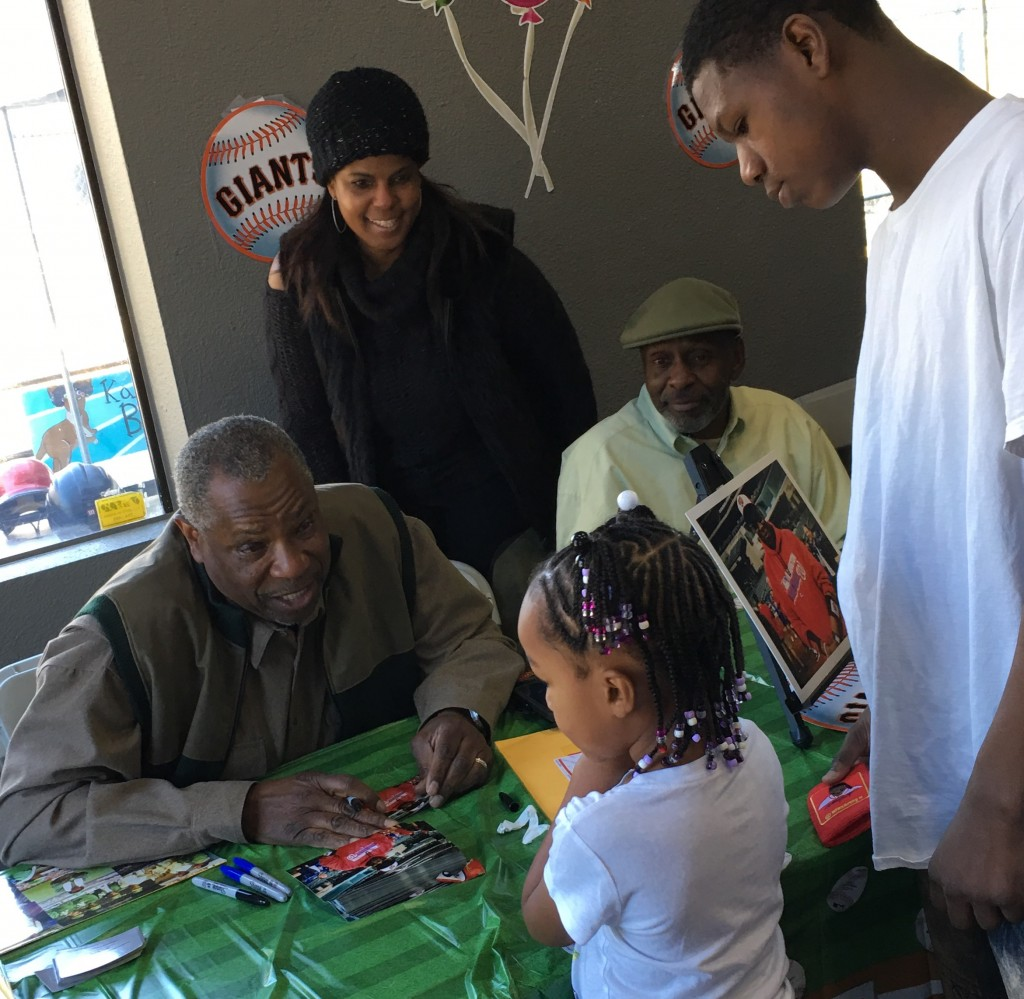 Dusty Baker talks with little fan during an autograph signing at Kangazoom in Antioch, on Sunday, Dec. 18, 2016. photo courtesy of Toi Crawford