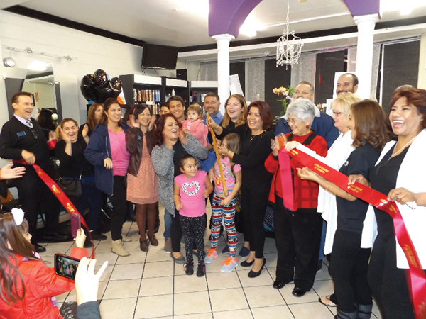 Owner Gricelda Gomez  (with scissors) celebrates the one year anniversary of her salon located at 714 W. 10th St. with Antioch's city and business leaders, and massage therapist Victoria Green (far right) on Tuesday, Nov. 22.