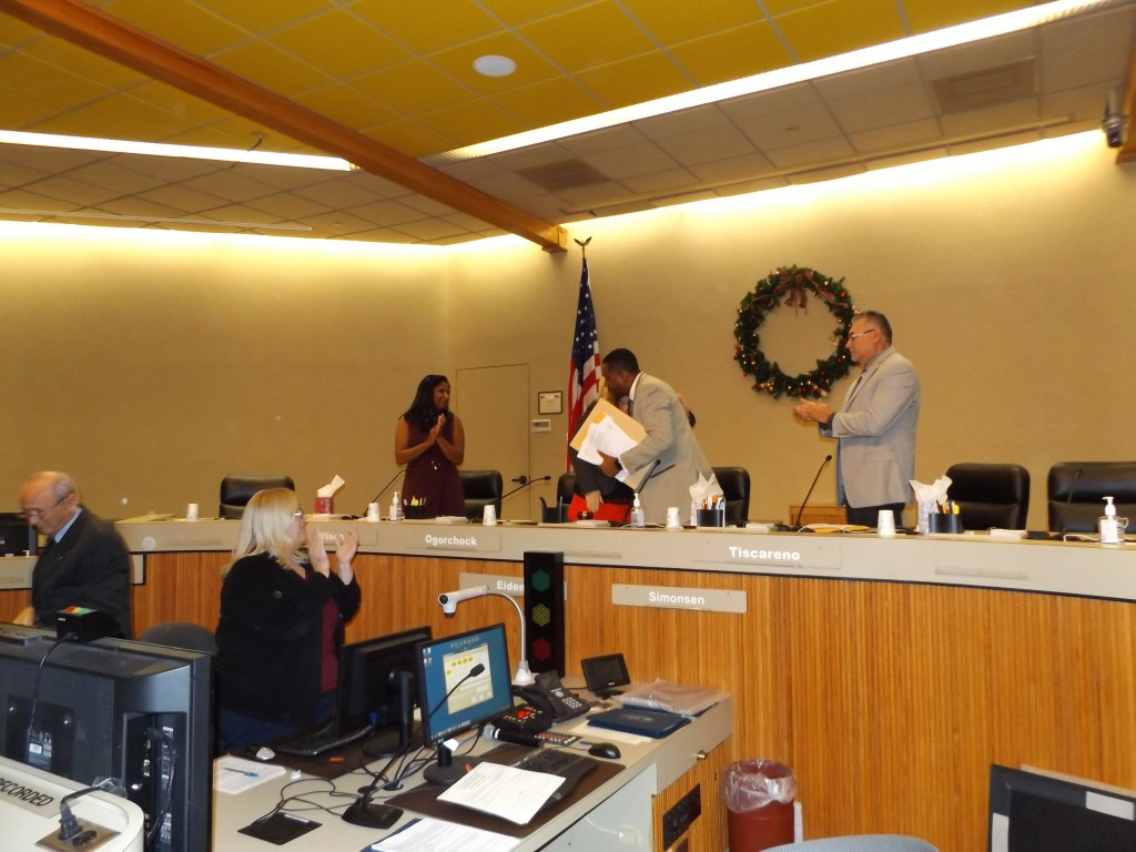 Out-going Mayor Wade Harper is hugged by then-Mayor Pro Tem Lori Ogorchock as he leaves the Council dais for the final time on Thursday, December 8, 2016.