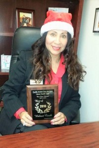 Pacific Senior Care Services owner Kelly Gonzales with the 2016 award from Best Businesses of Walnut Creek.