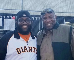 Kangazoom owner-manager Marcus Jefferson enjoys a moment with Dusty Baker.