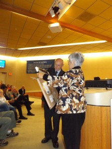 City Clerk Arne Simonsen presents out-going Councilwoman Mary Rocha with a photo from First 5 of Contra Costa.