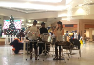 The Soca Sisters and Company steel pan band performed for holiday shoppers at the mall.