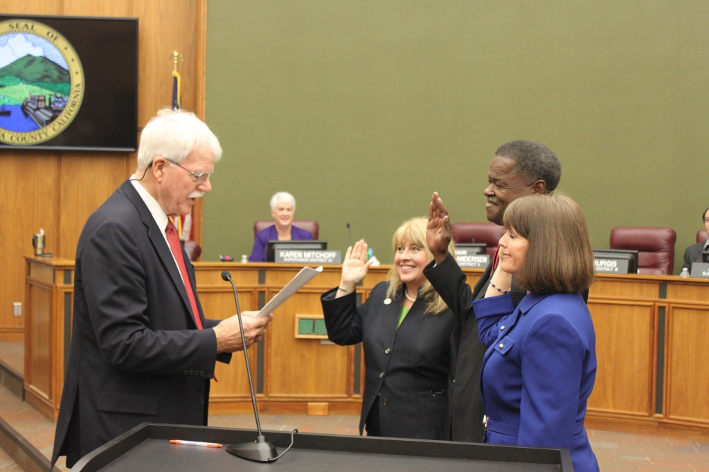 Former Congressman George Miller administers the oaths of office to new Contra Costa County Supervisor Diane Burgis, left, and re-elected Supervisors Federal Glover and Candace Andersen, Tuesday, January 10, 2017 as Supervisors Karen Mitchoff and John Gioia look on. photos by Jonathan Bash