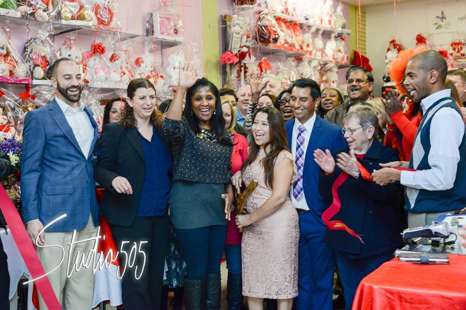 Owner Sylvia Sandoval, her husband Valentin, friends, and Antioch community and business leaders celebrate the ribbon cutting of Sylvia's Florist on A Street, Friday, Jan. 27, 2017. photo by Casey Quist