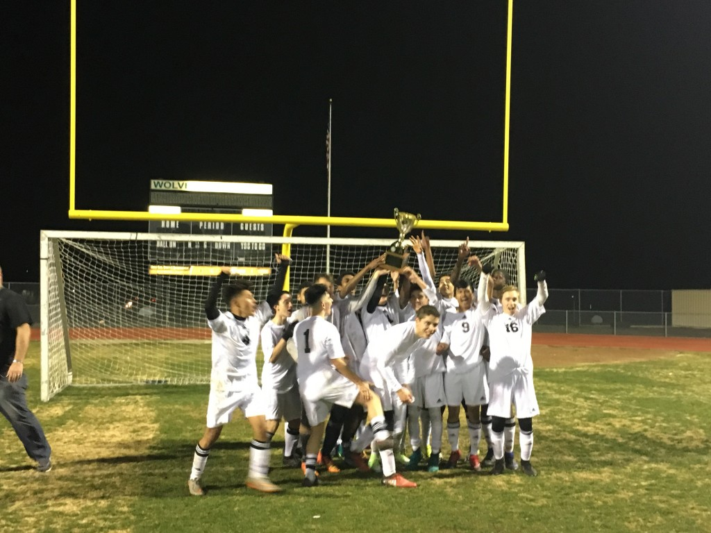 Deer Valley High boys soccer team celebrates retaining the Mayor's Cup following the match with Antioch High, Tuesday night, Jan. 31, 2017. photo by Jesus Cano