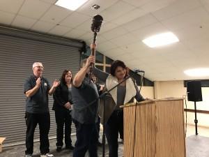 Jeff Warrenburg foundation Board President for 2016 hands off the oversized gavel to 2017 President Felicia Cursi.